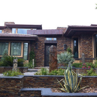 Example of a trendy stone exterior home design in Las Vegas