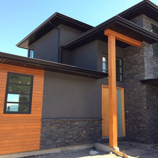 Inspiration for a modern gray stucco exterior home remodel in Vancouver