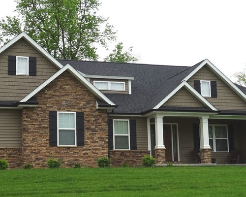 Example of a mid sized arts and crafts brown two story stone exterior home