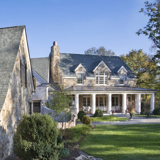 Large elegant brown two-story stone gable roof photo in Nashville with a shingle roof