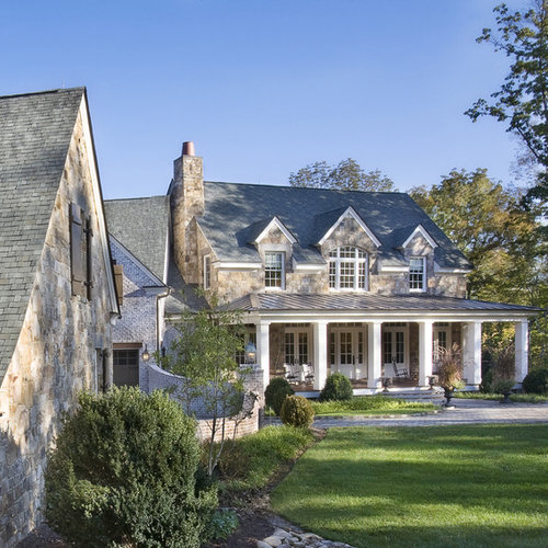 architectural shingles. Large Elegant Brown Two-story Stone Gable Roof Photo In Nashville With A Shingle Architectural Shingles