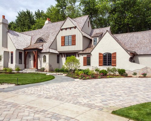 Stone Stucco Elevation : Whimsical stone stucco and board batten chateau in