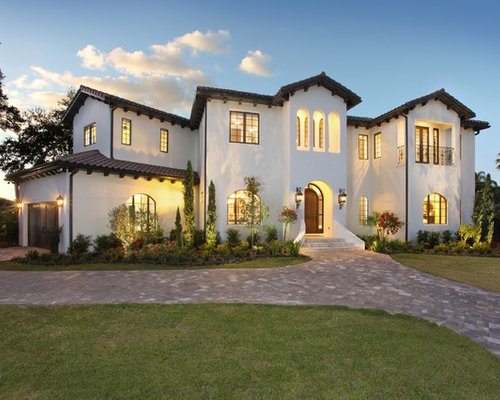 mid sized mediterranean white two story stucco exterior home idea in tampa with a