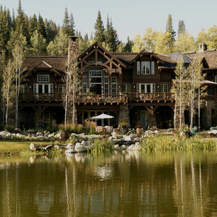 Inspiration for a rustic wood exterior home remodel in Denver