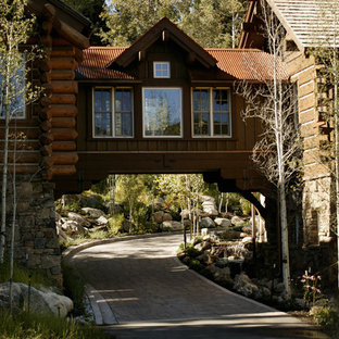 Mountain style two-story wood exterior home photo in Denver