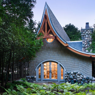Eclectic one-storey grey exterior in Seattle with wood siding and a gable roof.
