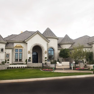 Large transitional beige two-story concrete exterior home idea in Phoenix with a tile roof