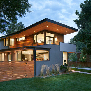Mid-sized trendy gray two-story stucco exterior home photo in Denver