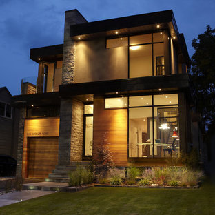 Inspiration for a contemporary two-story exterior home remodel in Toronto