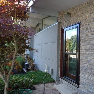 Diseño de fachada gris, vintage, de tamaño medio, de una planta, con revestimiento de estuco
