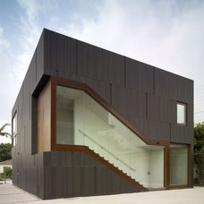 Contemporary Entry by Studio 0.10 Architects