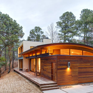 Inspiration for a contemporary wood exterior home remodel in New York