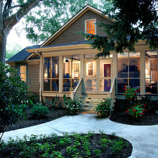 Inspiration for a timeless beige one-story exterior home remodel in Other
