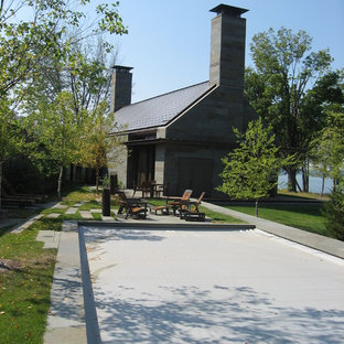 Example of a minimalist stone exterior home design in Minneapolis