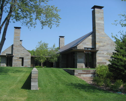 Inspiration For A Contemporary Stone Exterior Home Remodel In Minneapolis  With A Gable Roof