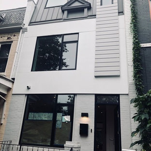 Inspiration for a modern white three-story brick house exterior remodel in Seattle