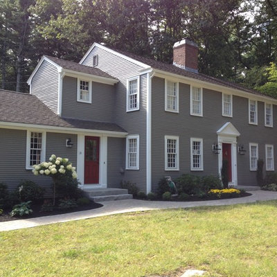 Large traditional gray two-story vinyl gable roof idea in Boston