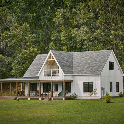 Example of a small cottage white two-story exterior home design in Other with a shingle roof