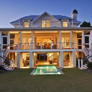 Coastal white three-story house exterior photo in Charleston with a metal roof