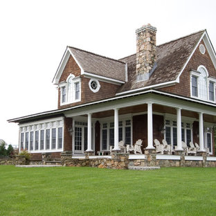 Large victorian brown two-story wood gable roof idea in Providence with a shingle roof