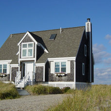 Beach Style Exterior by Essex Construction and Development, Inc.