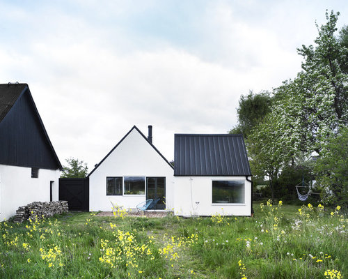 Black metal roof home design ideas pictures remodel and for Black roof house