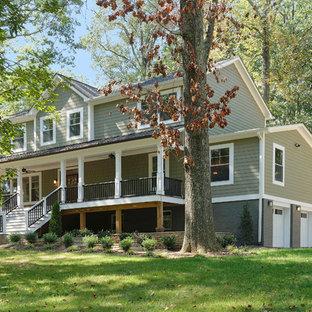 ワシントンD.C.のおしゃれな家の外観 (コンクリート繊維板サイディング、緑の外壁) の写真