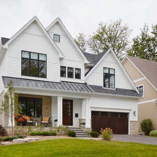 Mid-sized transitional white three-story concrete exterior home photo in Chicago