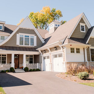 Mid-sized elegant gray two-story mixed siding exterior home photo in Chicago with a clipped gable roof