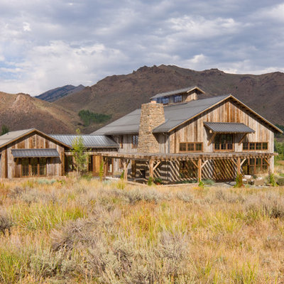 Inspiration for a rustic two-story wood gable roof remodel in Other