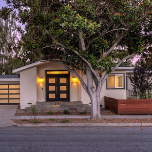 Mid-sized transitional beige one-story exterior home photo in San Francisco with a shingle roof