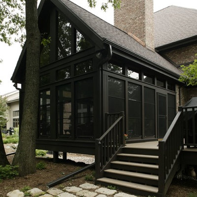 Inspiration for a large timeless brown one-story mixed siding exterior home remodel in Other with a shingle roof