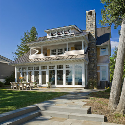 Large beach style two-story wood house exterior photo in Burlington