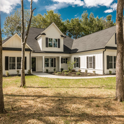 Large cottage white two-story mixed siding exterior home photo in Nashville with a shingle roof