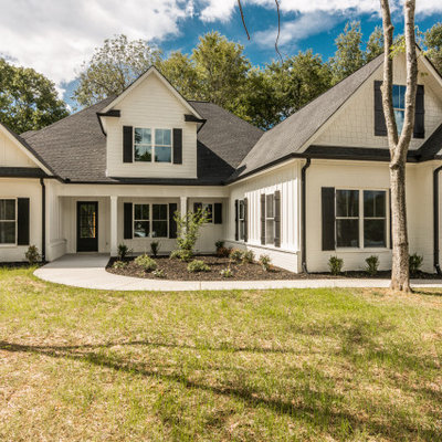 Inspiration for a large cottage white two-story mixed siding exterior home remodel in Nashville with a shingle roof