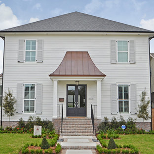 Mid-sized trendy white two-story concrete fiberboard exterior home photo in New Orleans
