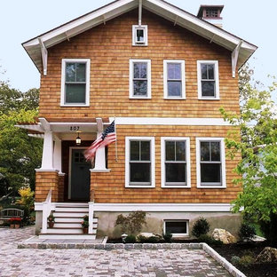 Mid-sized craftsman brown two-story wood exterior home idea in New York with a shingle roof