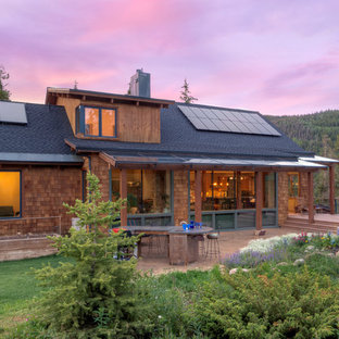 Rustic brown wood house exterior idea in Denver with a shingle roof