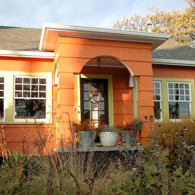 Inspiration for an eclectic orange exterior home remodel in Portland
