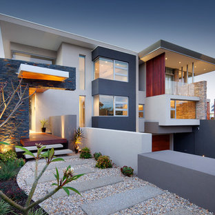 This is an example of a large contemporary exterior in Perth with a flat roof.