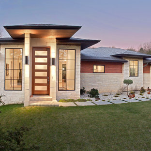 Inspiration for an asian one-storey beige house exterior in Other with mixed siding, a hip roof and a shingle roof.