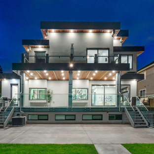 Inspiration for a large modern two-story metal house exterior remodel in Vancouver