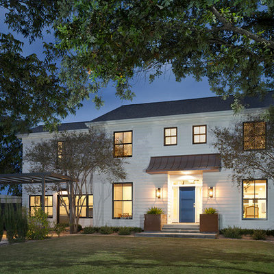 Large transitional white two-story vinyl exterior home photo in Austin with a shingle roof