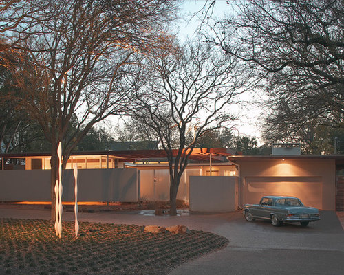 Mid-sized 1950s one-story exterior home idea in Austin - Mid Century Modern Landscaping Houzz