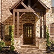 Traditional Exterior by Tatum Building Corp