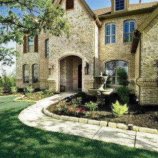 Example of a classic brick exterior home design in Dallas
