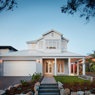 Inspiration for a traditional two-storey grey house exterior in Melbourne with a hip roof and a metal roof.