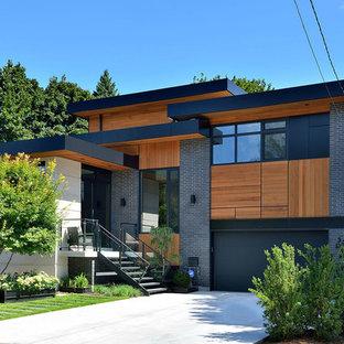 Großes, Zweistöckiges, Graues Modernes Haus mit Mix-Fassade und Flachdach in Toronto