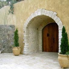Mediterranean Exterior by Taylor Lombardo Architects