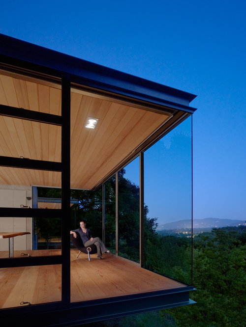 Small minimalist one-story glass flat roof photo in San Francisco